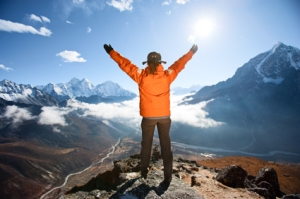 Woman looking through binoculars at Pumori in Mount Everest Nati